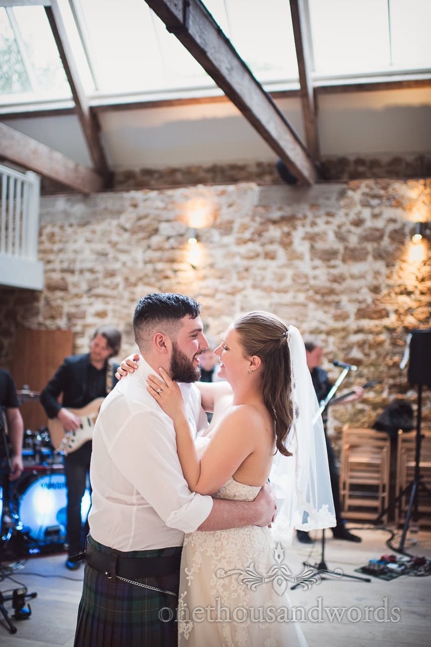 The new Mr and Mrs take their first dance at the Tithe Barn Symondsbury Wedding