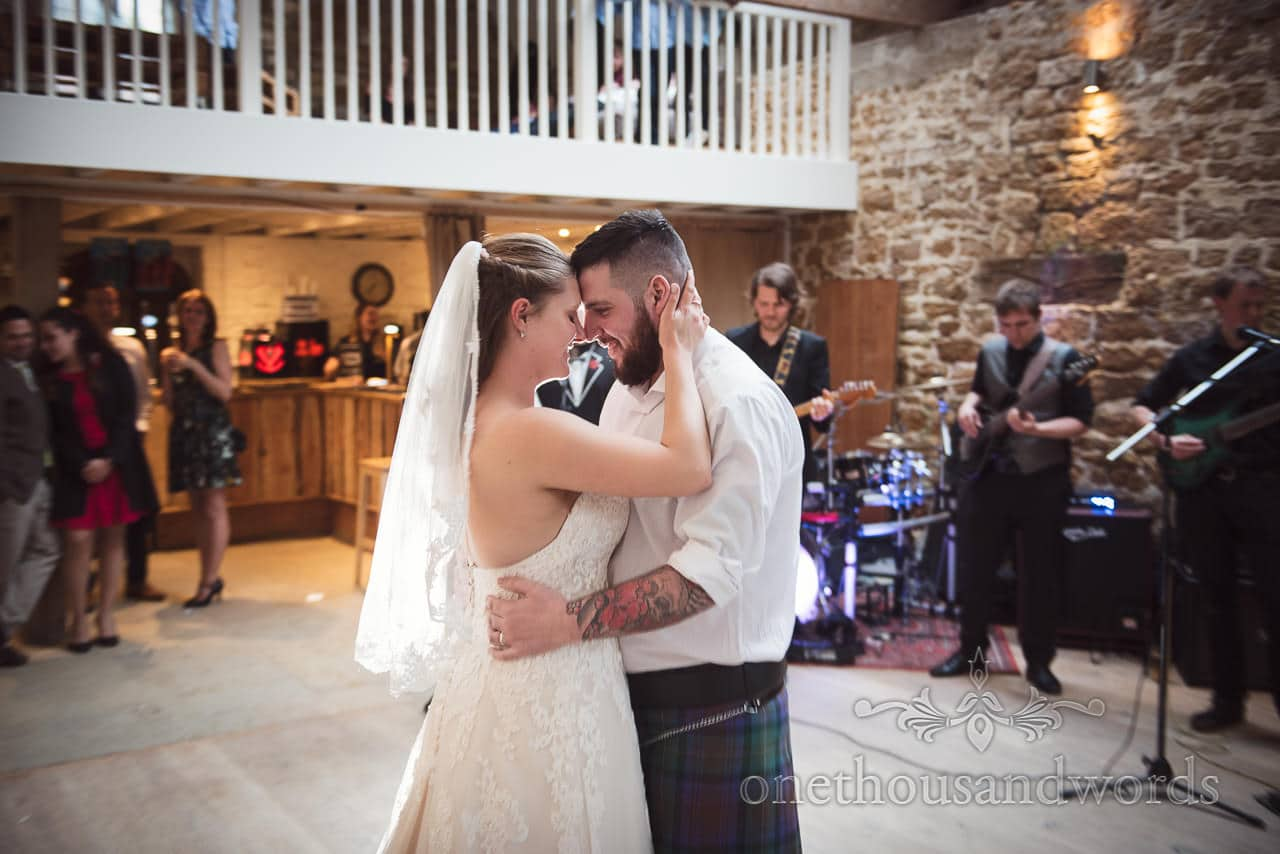 The newlyweds take their first dance at the Tithe Barn Symondsbury Wedding