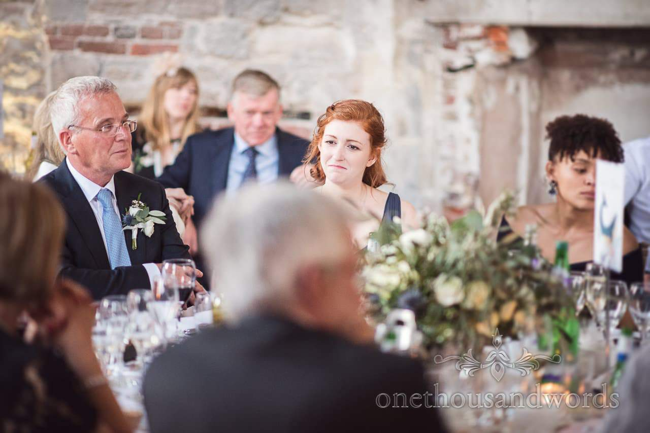 Top table at Lulworth Castle Wedding crying during wedding speeches in Dorset
