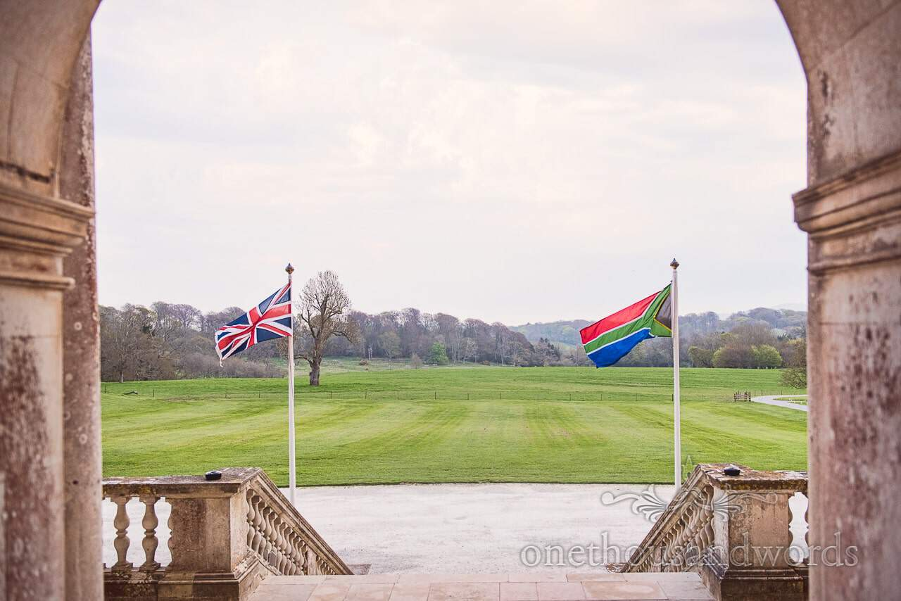 Union Jack and South African Flag fly in the grounds of Lulworth Castle Wedding