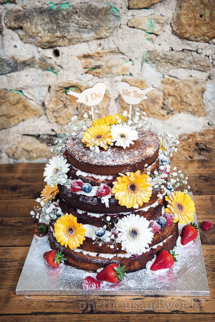 Wedding cake decorated with fruits and flowers form Tithe Barn Symondsbury Wedding