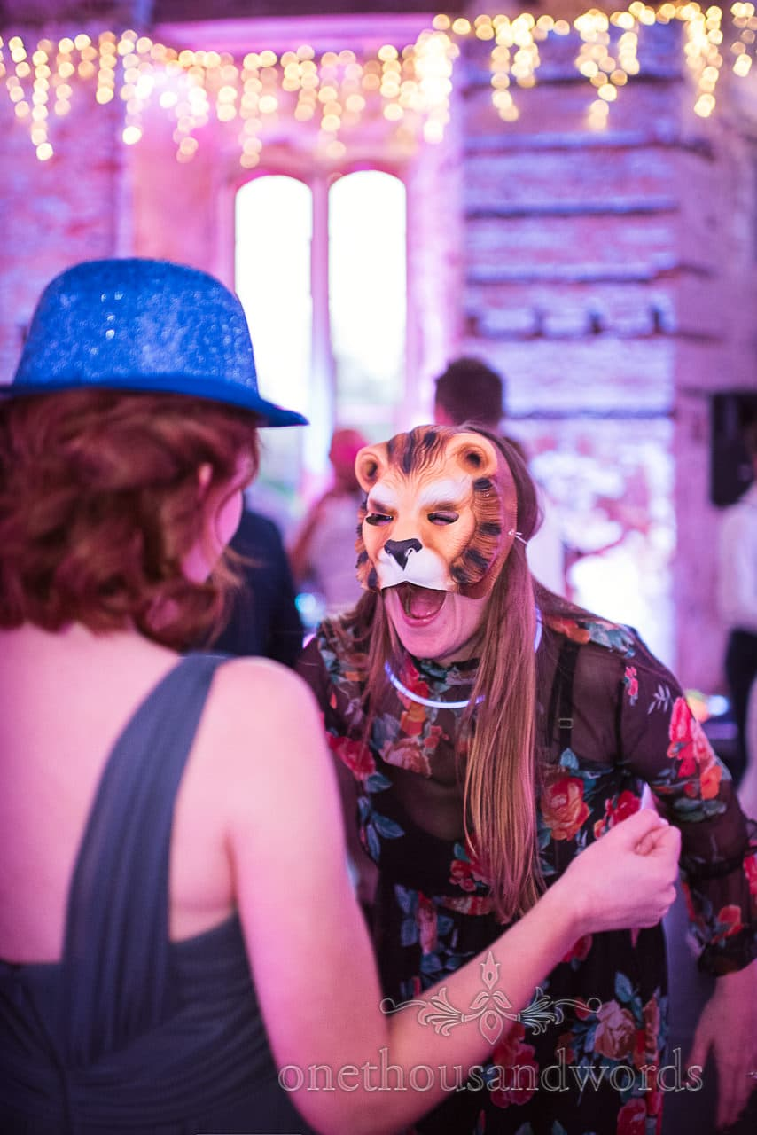 Wedding guest in lion mask at Lulworth Castle Wedding evening reception