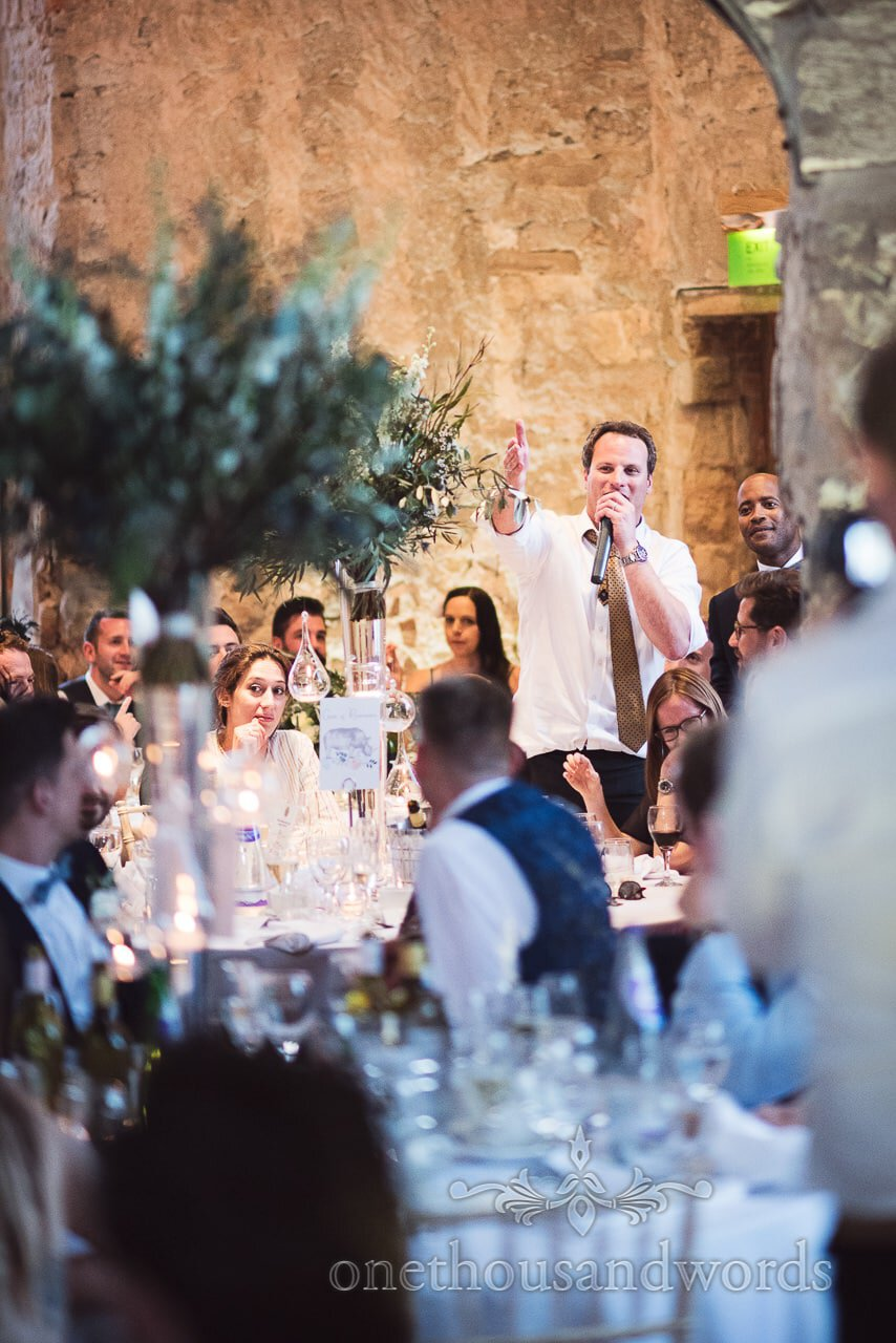 Wedding guest joins in speeches at Lulworth Castle Wedding venue in Dorset