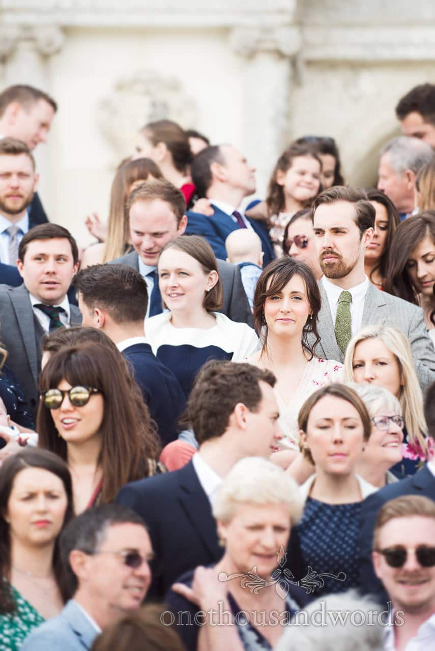 wedding guest portrait within a group photograph by one thousand words