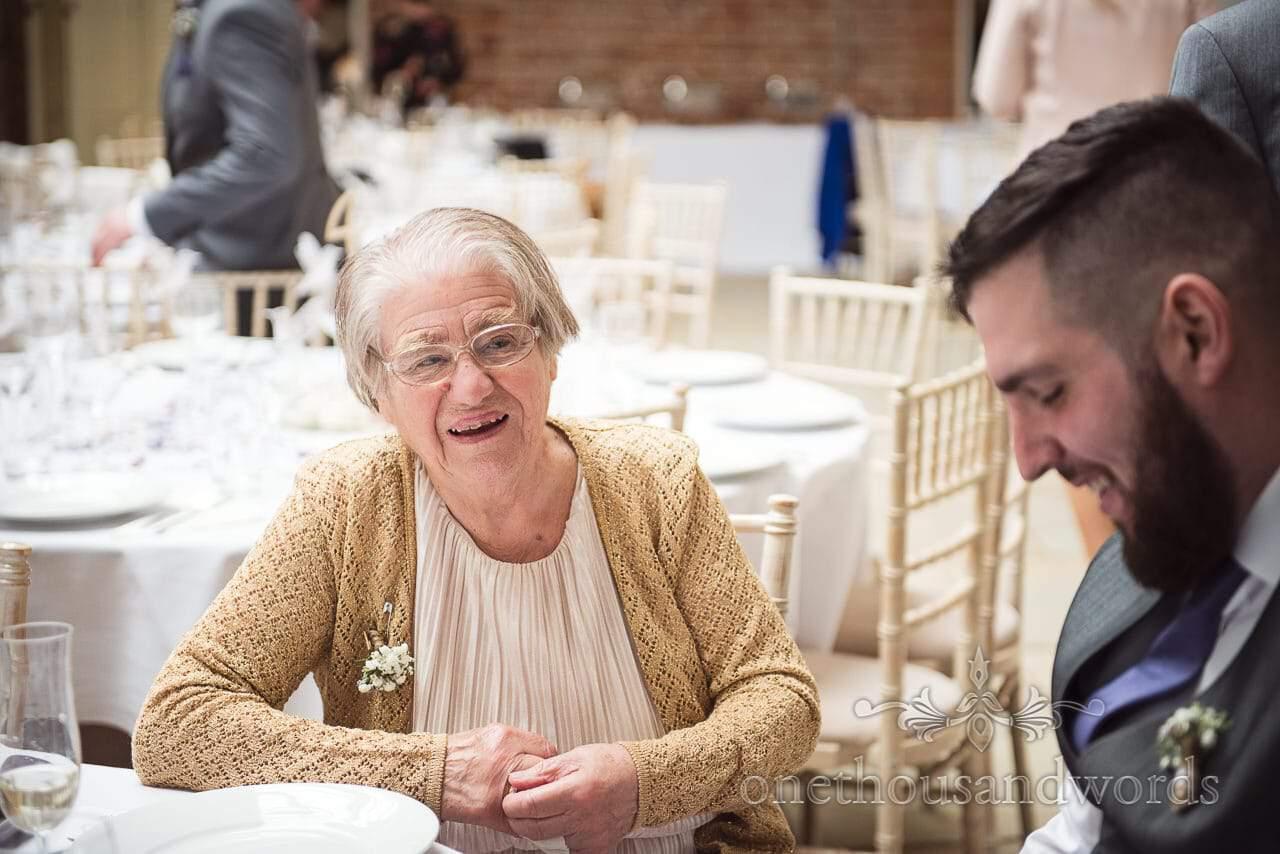 Wedding guest with groom at Tithe Barn Symondsbury Wedding