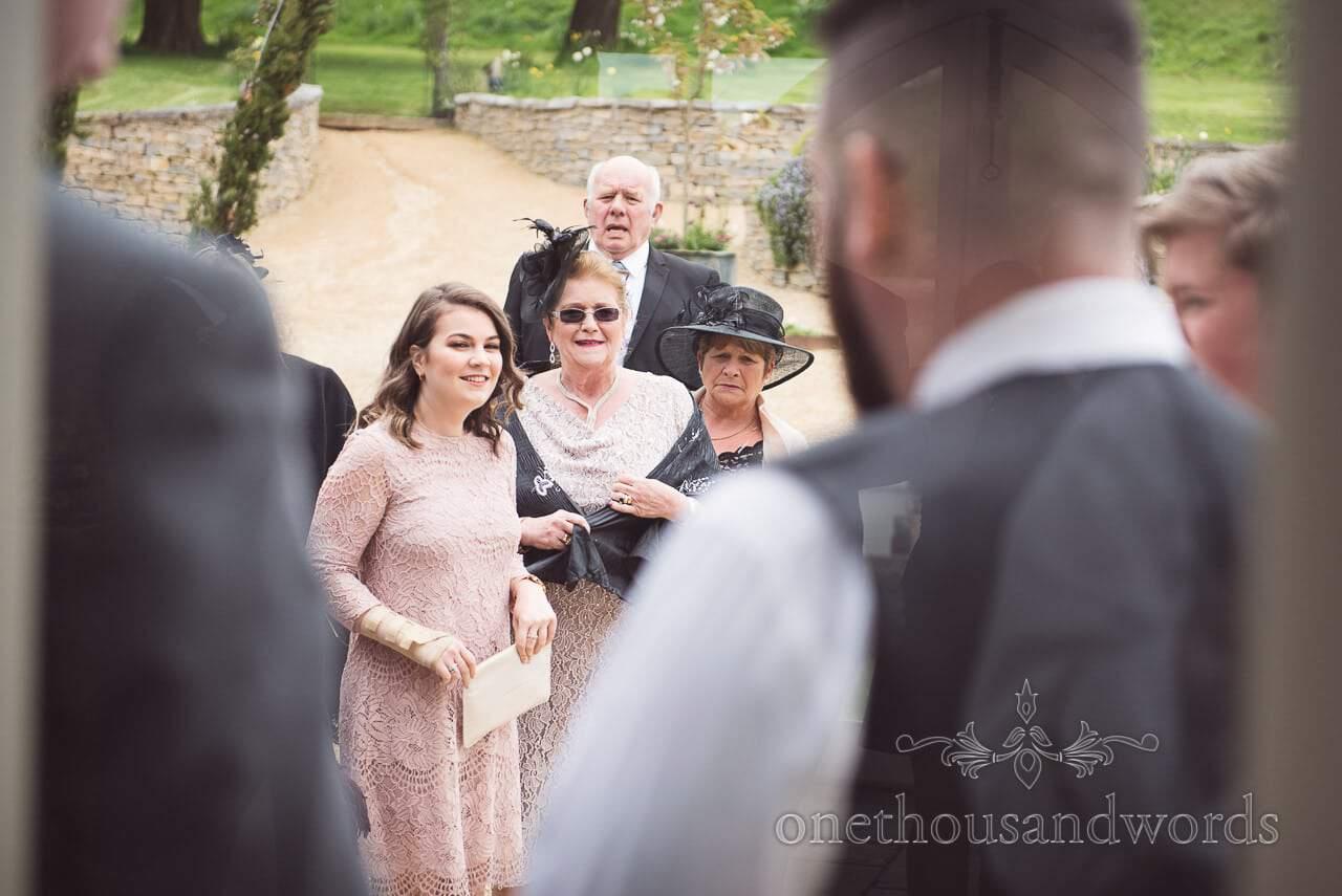 Wedding guests arrive for Tithe Barn Symondsbury Wedding