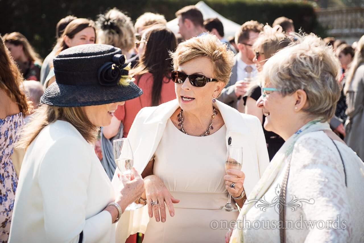 Wedding guests enjoying drinks reception at Lulworth Castle Wedding