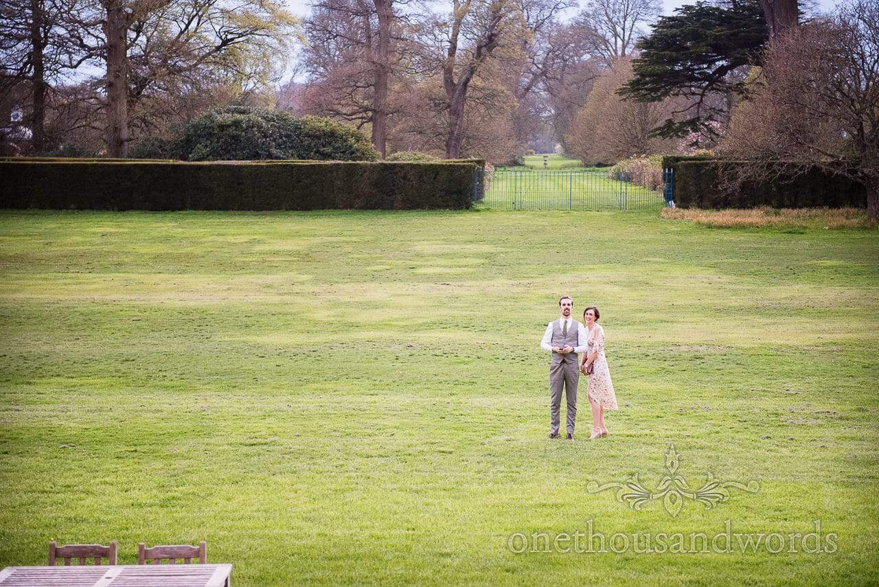 Wedding guests in the grounds of Lulworth Castle Wedding venue in Dorset