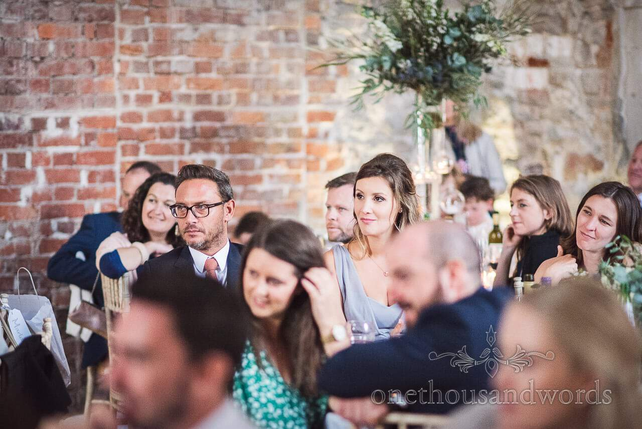 Wedding guests listening to Lulworth Castle Wedding speeches photograph