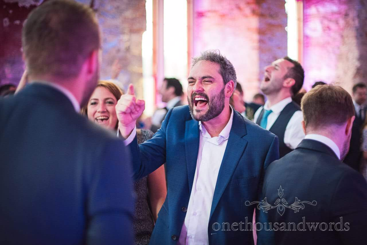 Wedding guests singing on the dance floor at Lulworth Castle Wedding venue