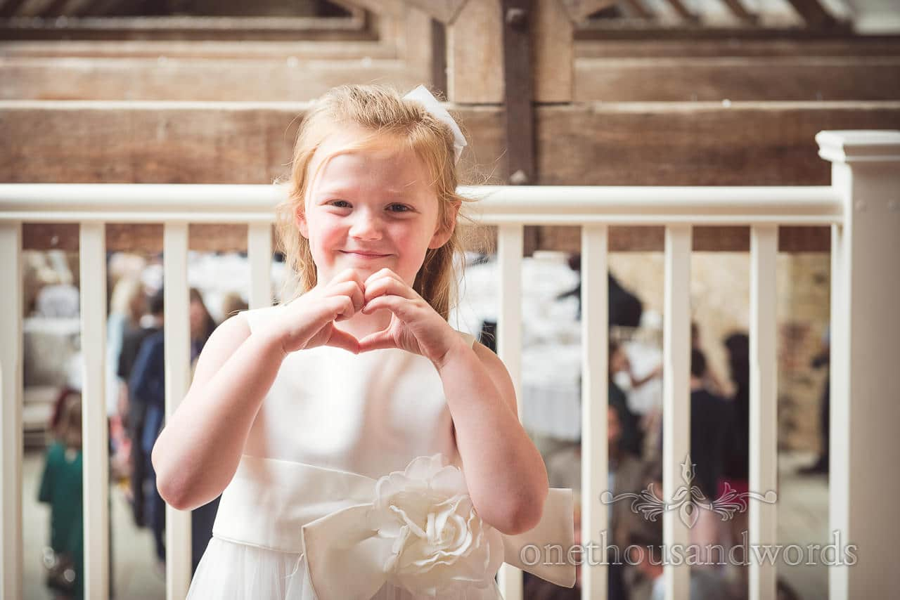 Young wedding guest sends a message at Tithe Barn Symondsbury Wedding