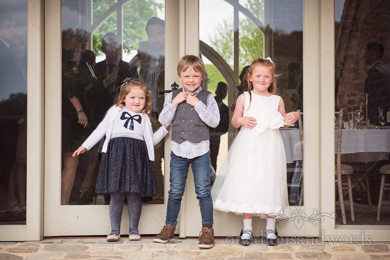 Young wedding guests before Tithe Barn Symondsbury Wedding