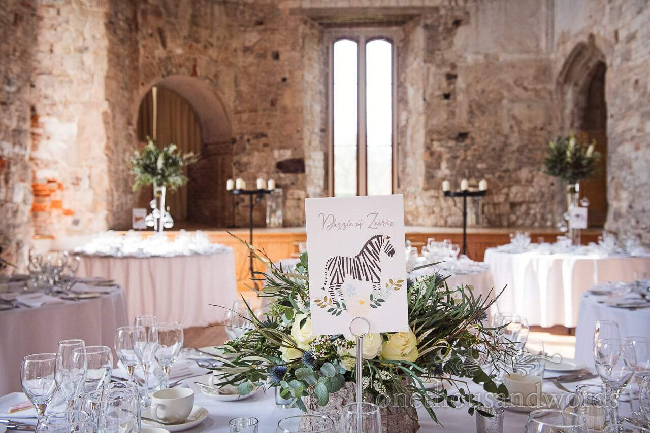 Zebra table name card at wedding breakfast from Lulworth Castle Wedding Photos