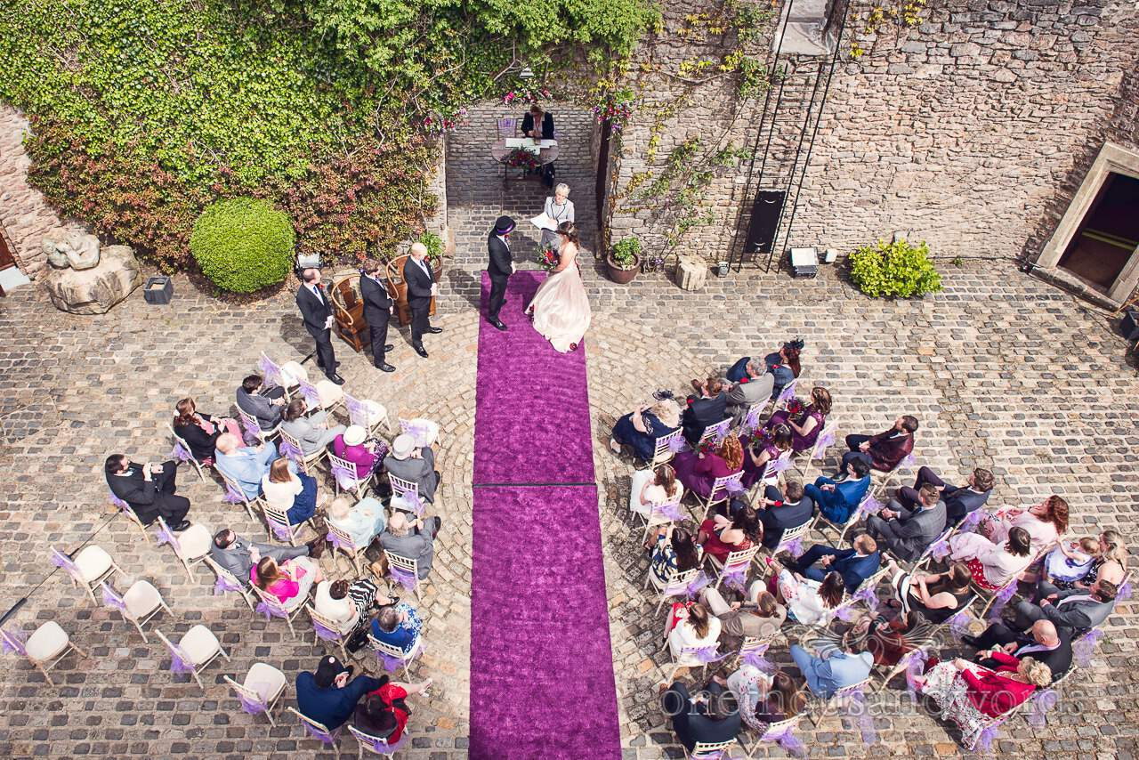 Aerial view of wedding ceremony with purple carpet at Walton Castle