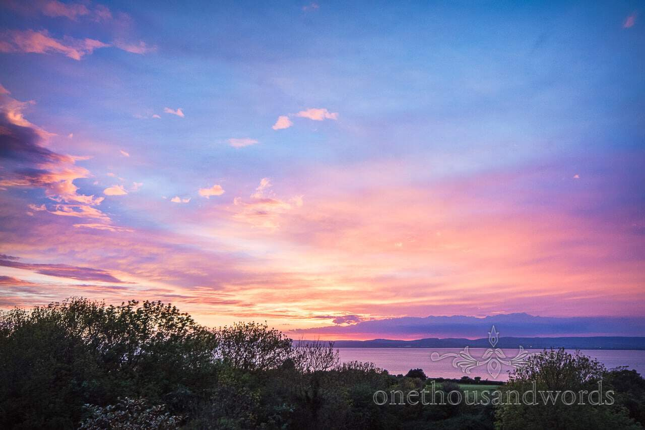 Beautiful sunset over Bristol Channel at Walton Castle wedding photographs