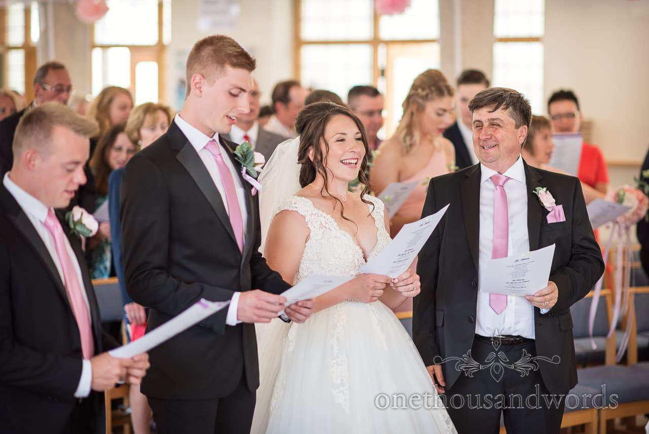 Best man , Father of the bride and bride and groom all sing during ceremony