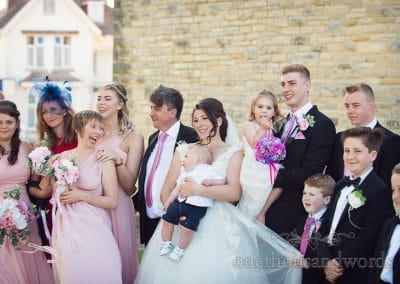 Bridal party are gathered for group photo from Swanage church wedding