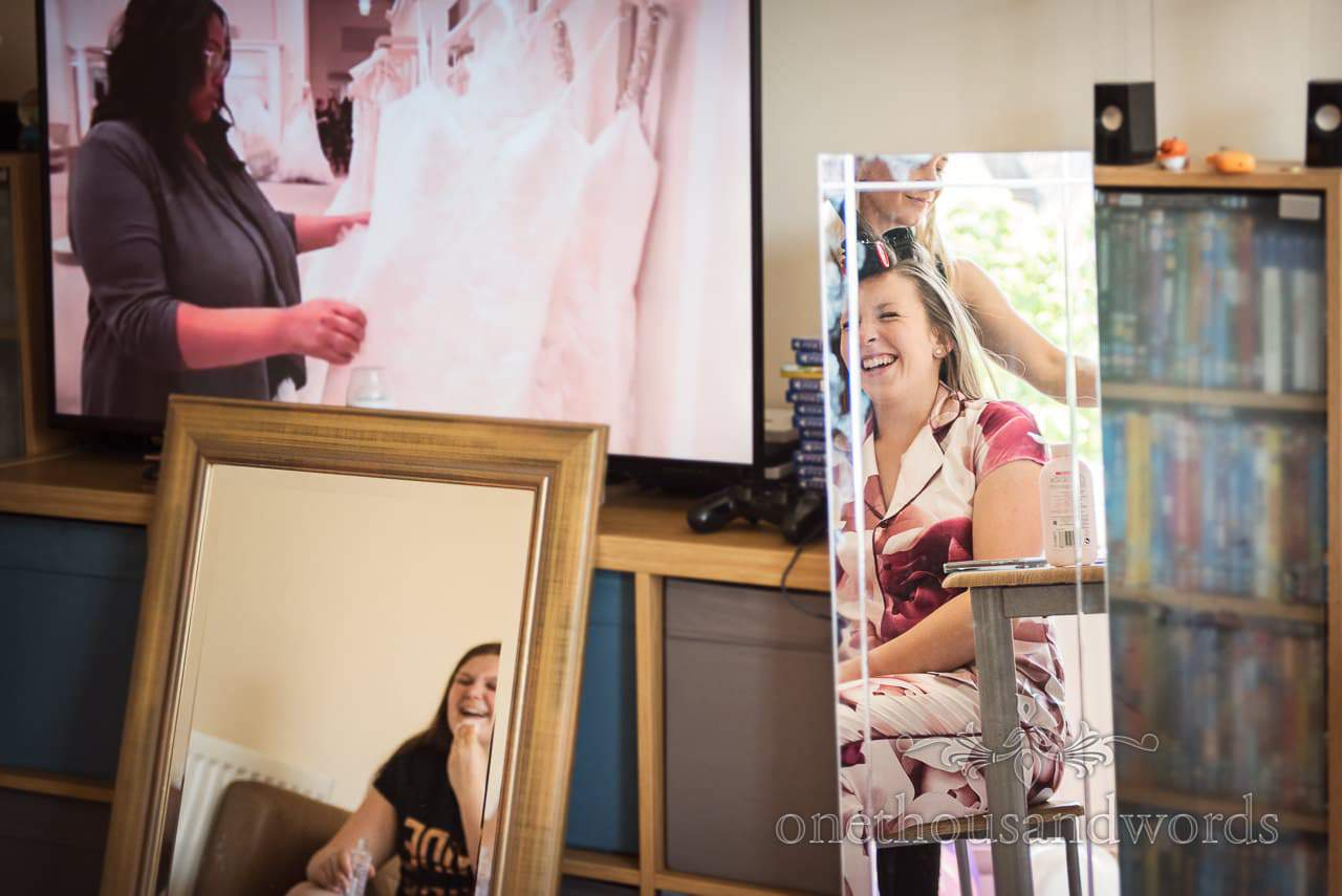 Bride and bridesmaid in mirrors on morning of Swanage Wedding Photos
