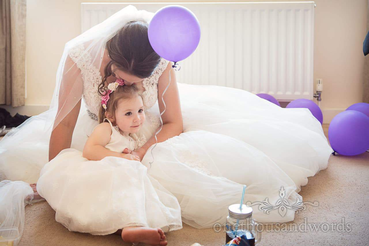 Bride and daughter share a moment on morning of Swanage wedding photos