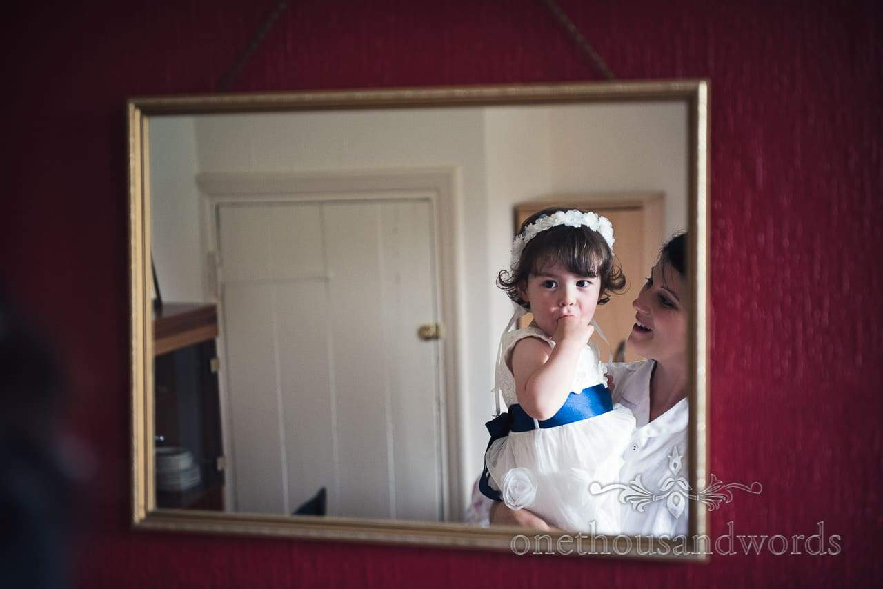 Bride and flower girl in mirror on morning of Countryside Wedding Photos