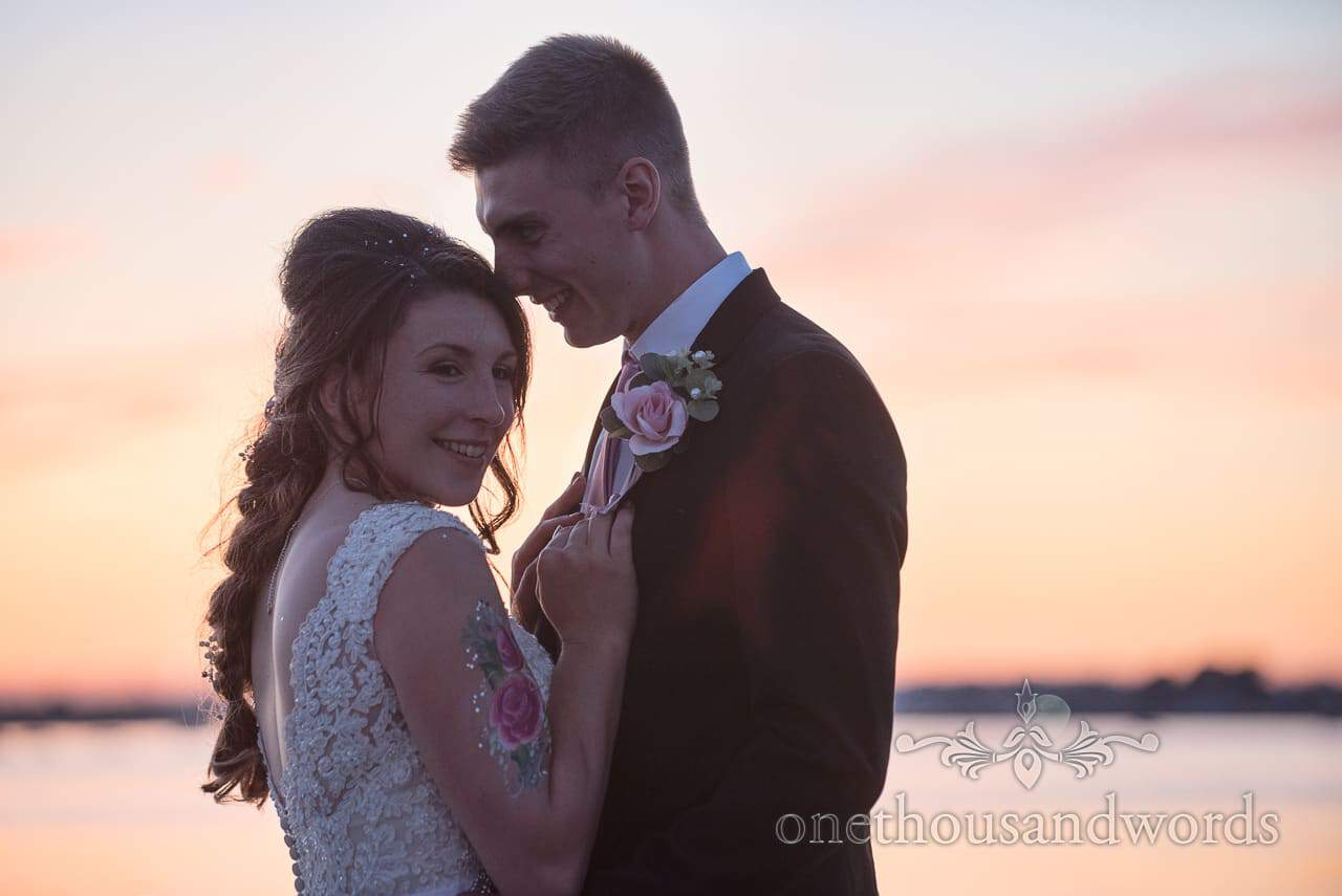 Bride and groom share embrace at sunset from Swanage Wedding Photos