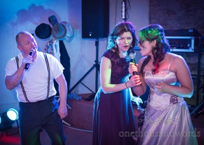 Bride and sister sing duet with Phil Collins act at Walton Castle Wedding