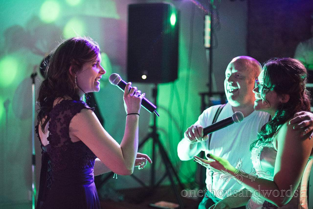 Bride and sister sing with Phil Collins act at Walton Castle Wedding