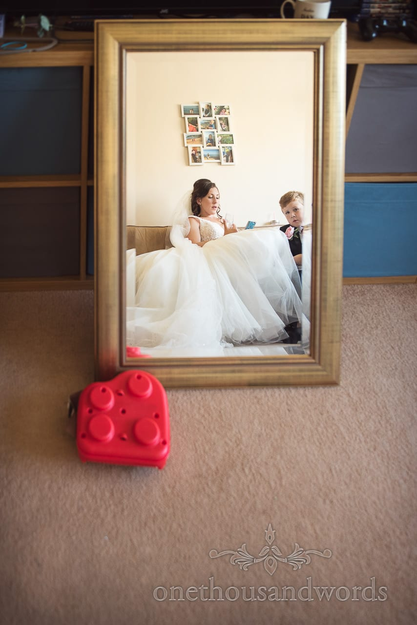 Bride and son in mirror on morning of Swanage wedding Photos