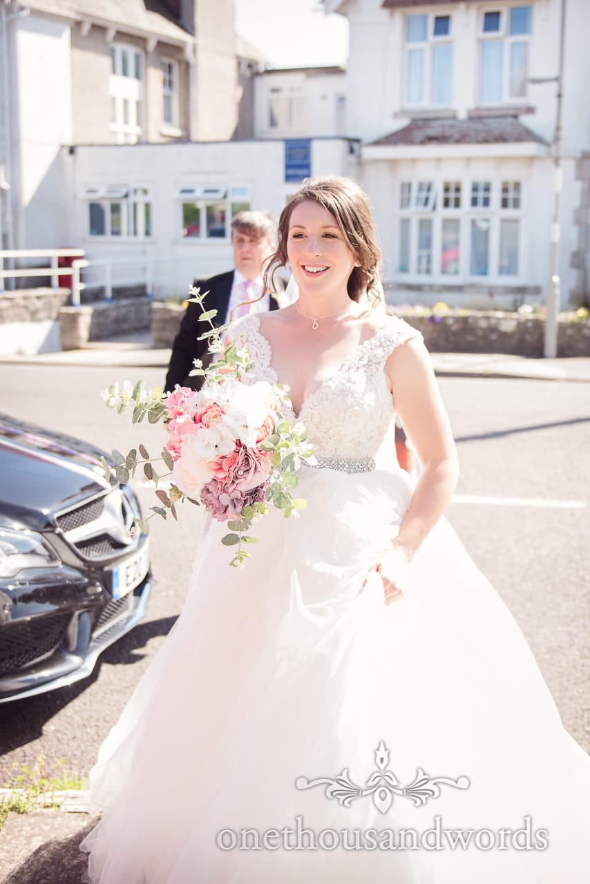 Bride arrives at church with father from Swanage wedding photos