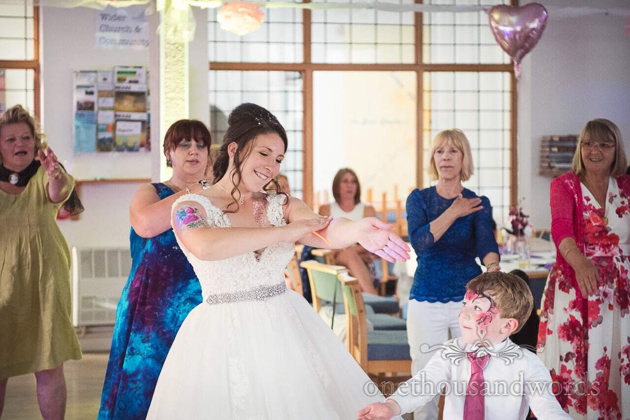 Bride dances with son and guests during Swanage Wedding Photos