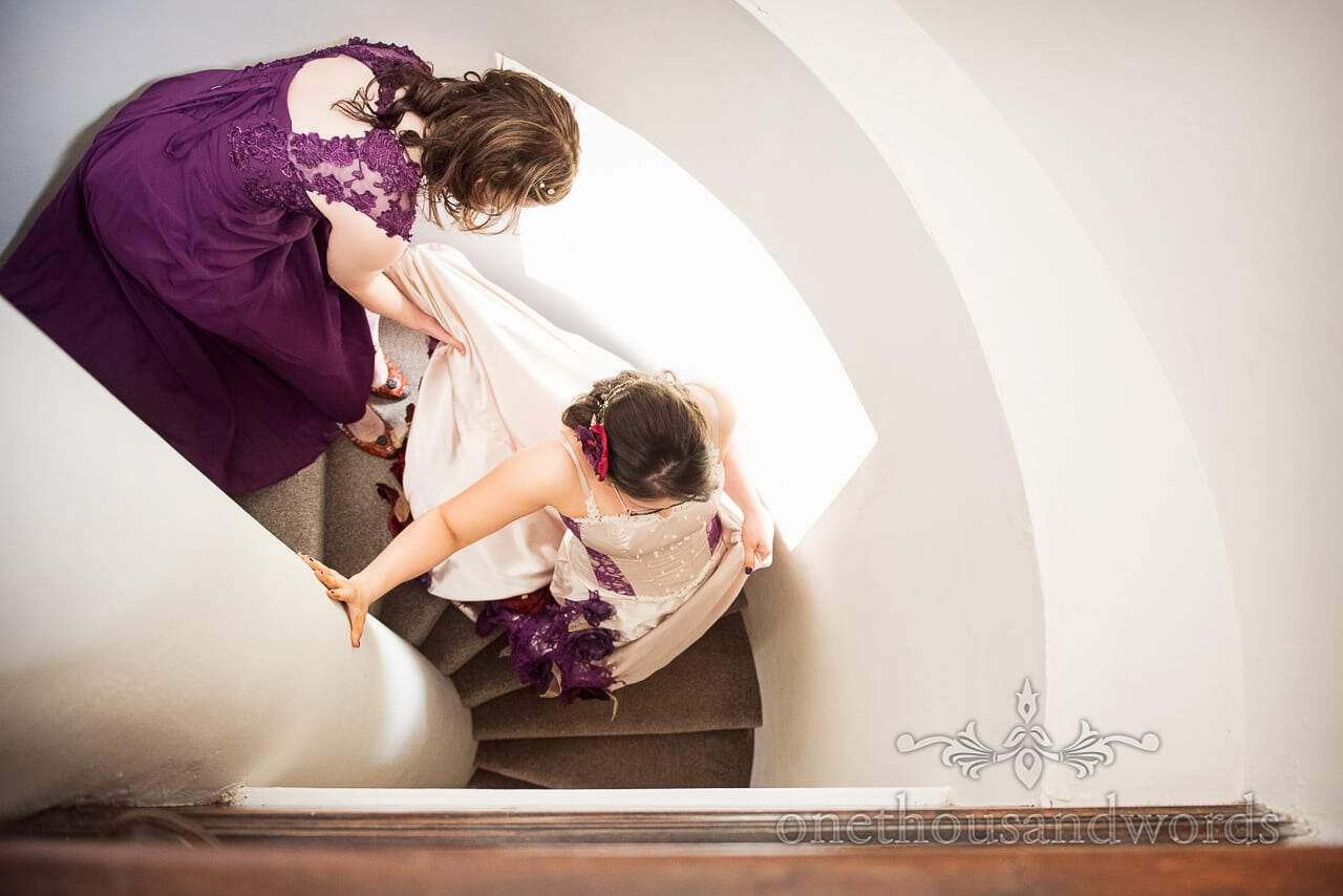 Bride descends Walton castle spiral stairs at Chocolate Themed Wedding