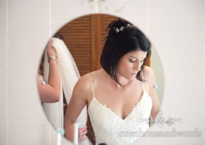 Bride in circular mirror from morning of Countryside Wedding Photos