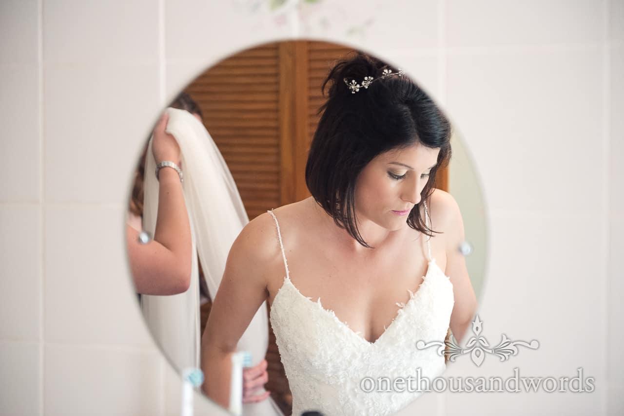 Bride in circular mirror from morning of Countryside Wedding Photos