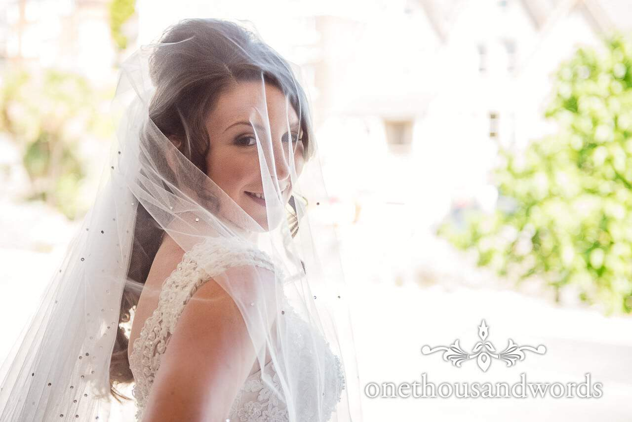 Bride in wedding and veil poses from Swanage Wedding Photos