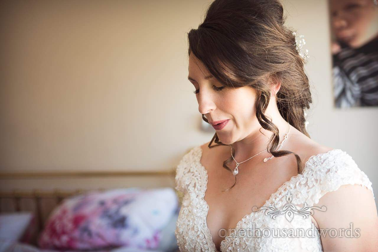 Bride in wedding dress takes a breath from Swanage Wedding Photos