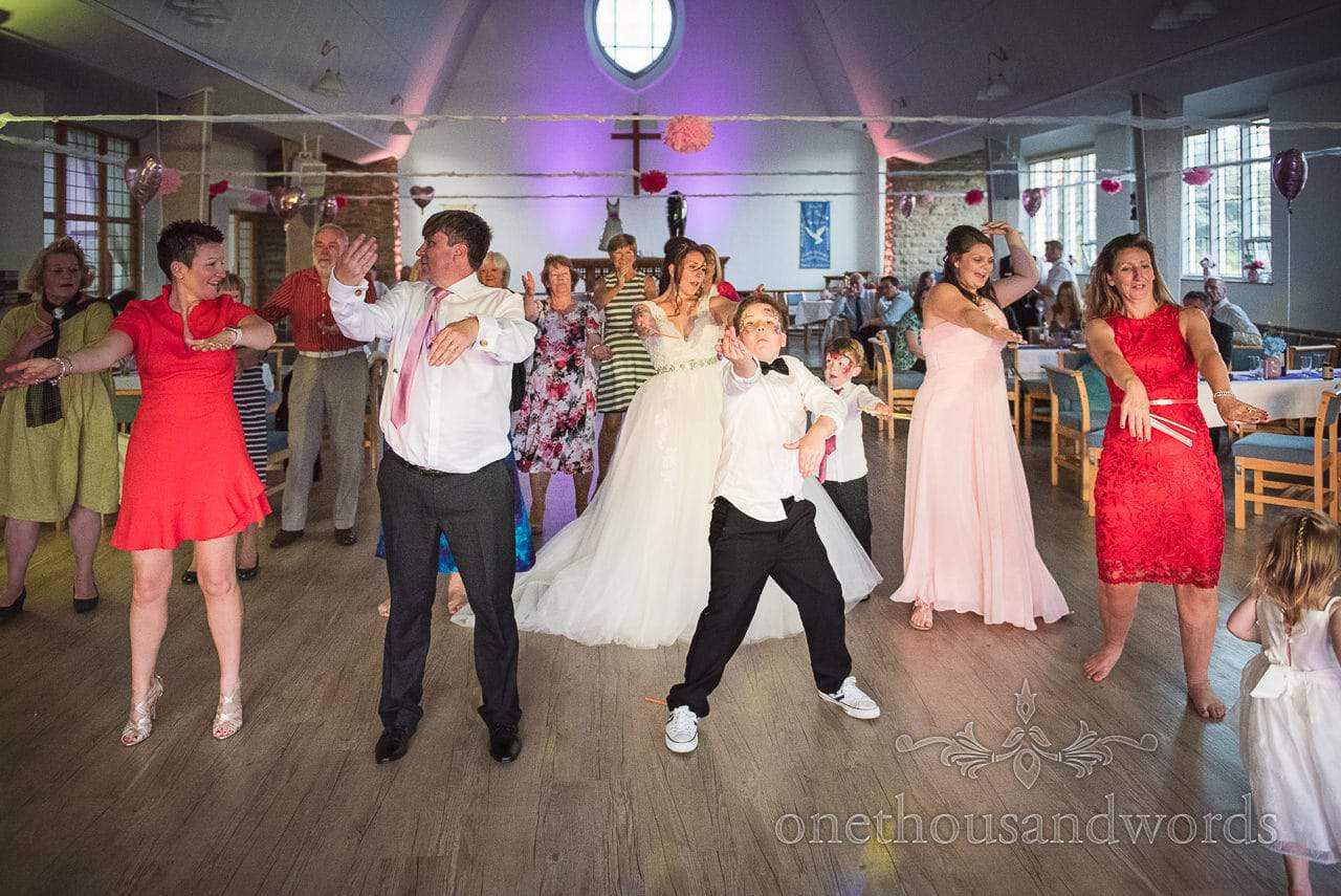 Bride is joined by family and guests on the dance floor from Swanage Wedding Photos