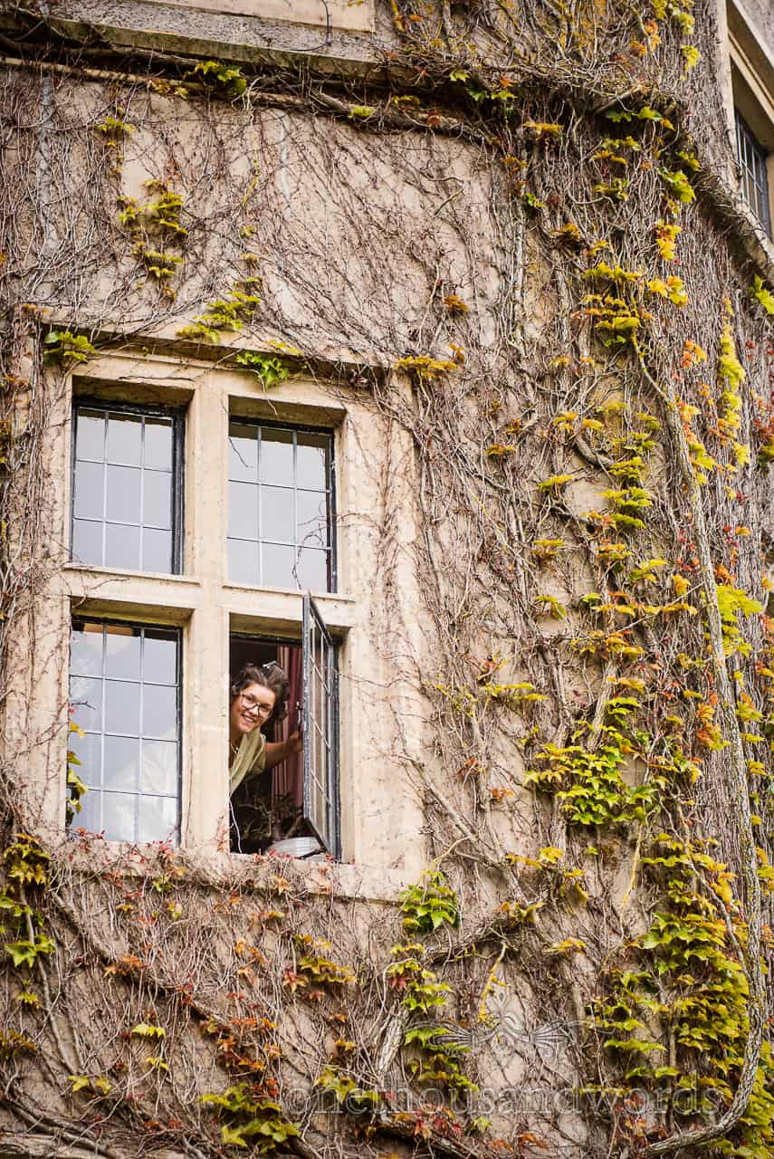 Bride looks out of castle window at Chocolate Themed Wedding Photographs