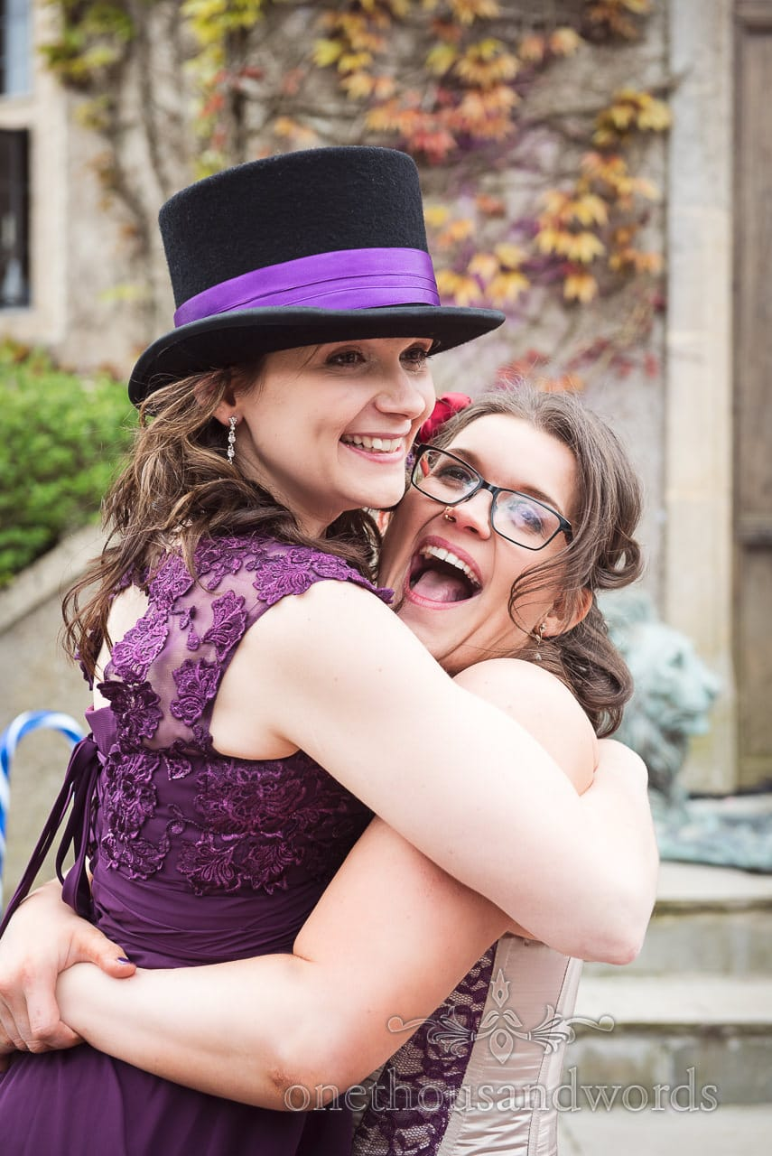 Bride picks up sister in wedding top hat at Chocolate Themed Wedding
