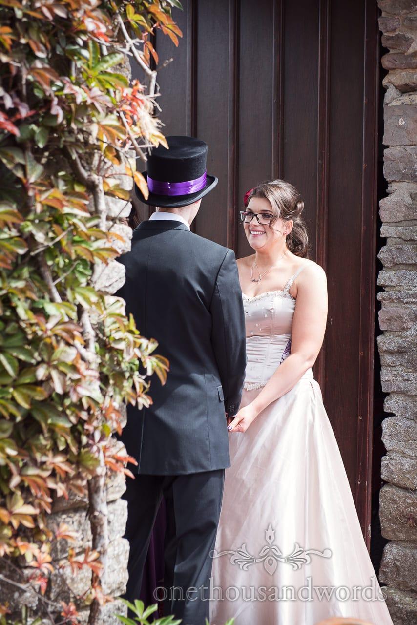 Bride smiling at groom at Walton Castle wedding venue in Bristol