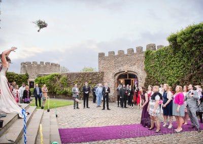 Bride throws wedding bouquet at Walton Castle wedding venue