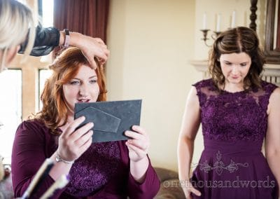Bridesmaid checks herself in mirror on morning of Chocolate Themed Wedding Photographs