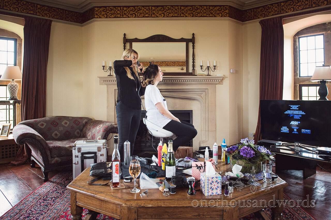 Bridesmaid has wedding hair styled on wedding morning in Walton castle wedding