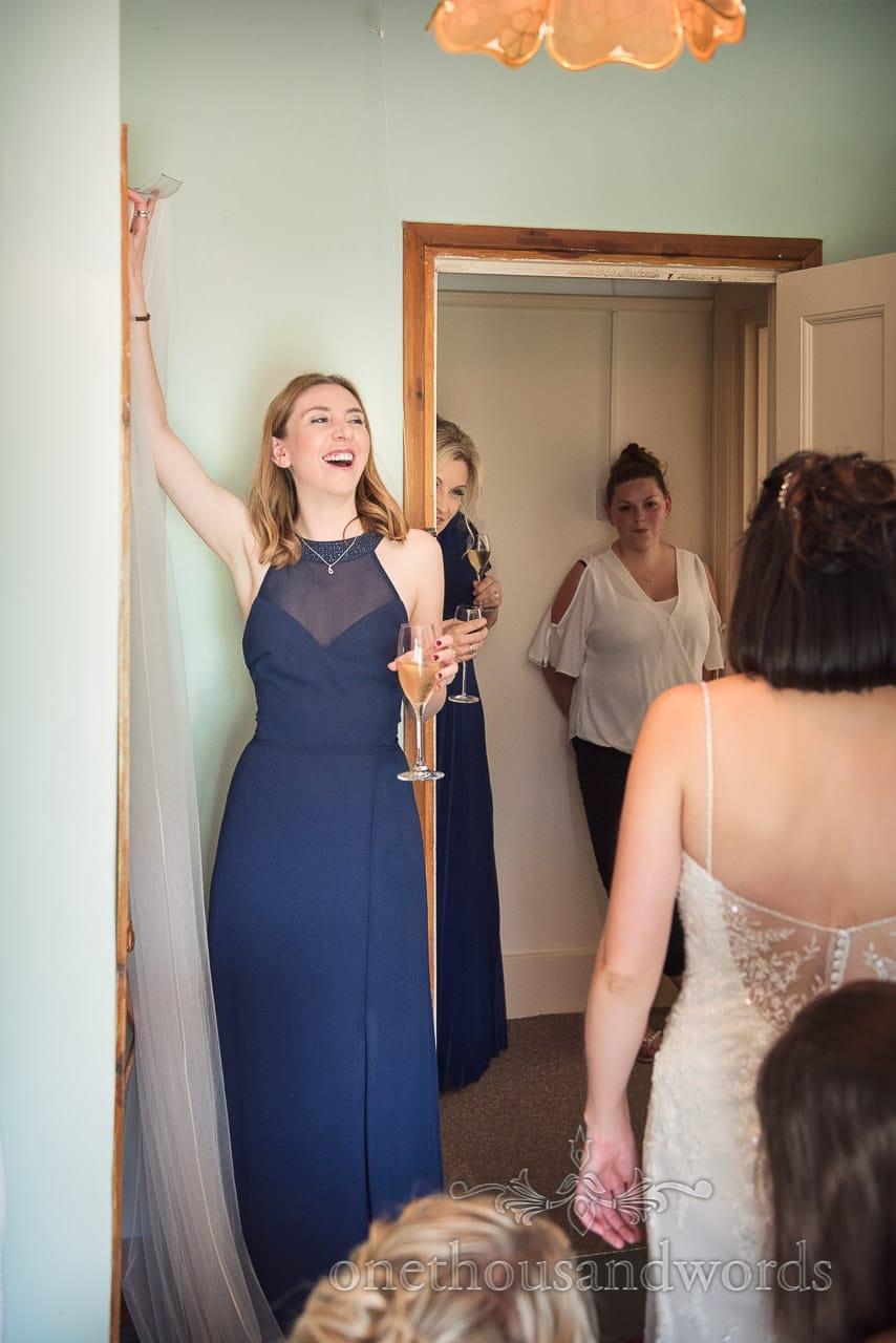 Bridesmaid shares a joke on wedding morning at Countryside Wedding Photos