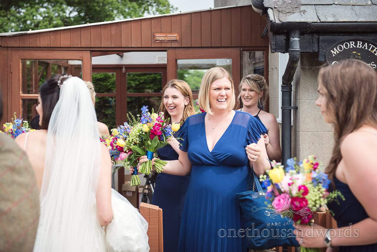 Bridesmaids in blue dresses prepare to leave for Countryside Wedding Photos