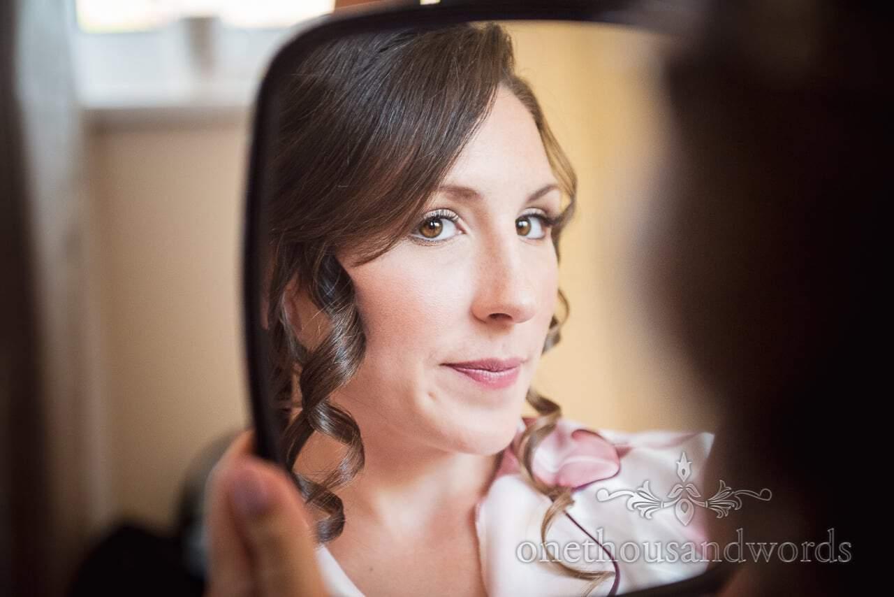 Bright eyed bride in mirror from Swanage Wedding Photos