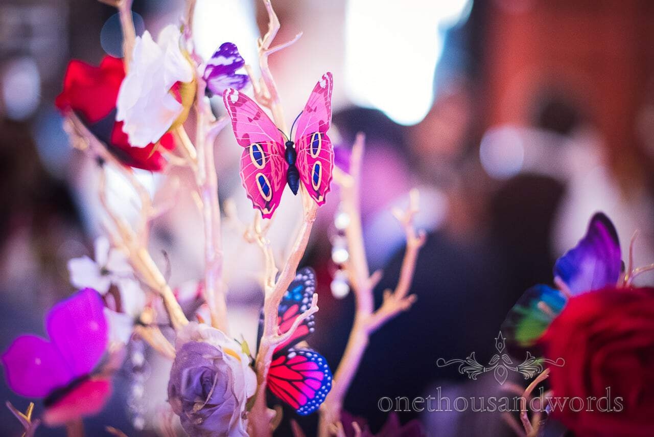 Butterfly decorations on white sticks at Chocolate Themed Wedding Photographs