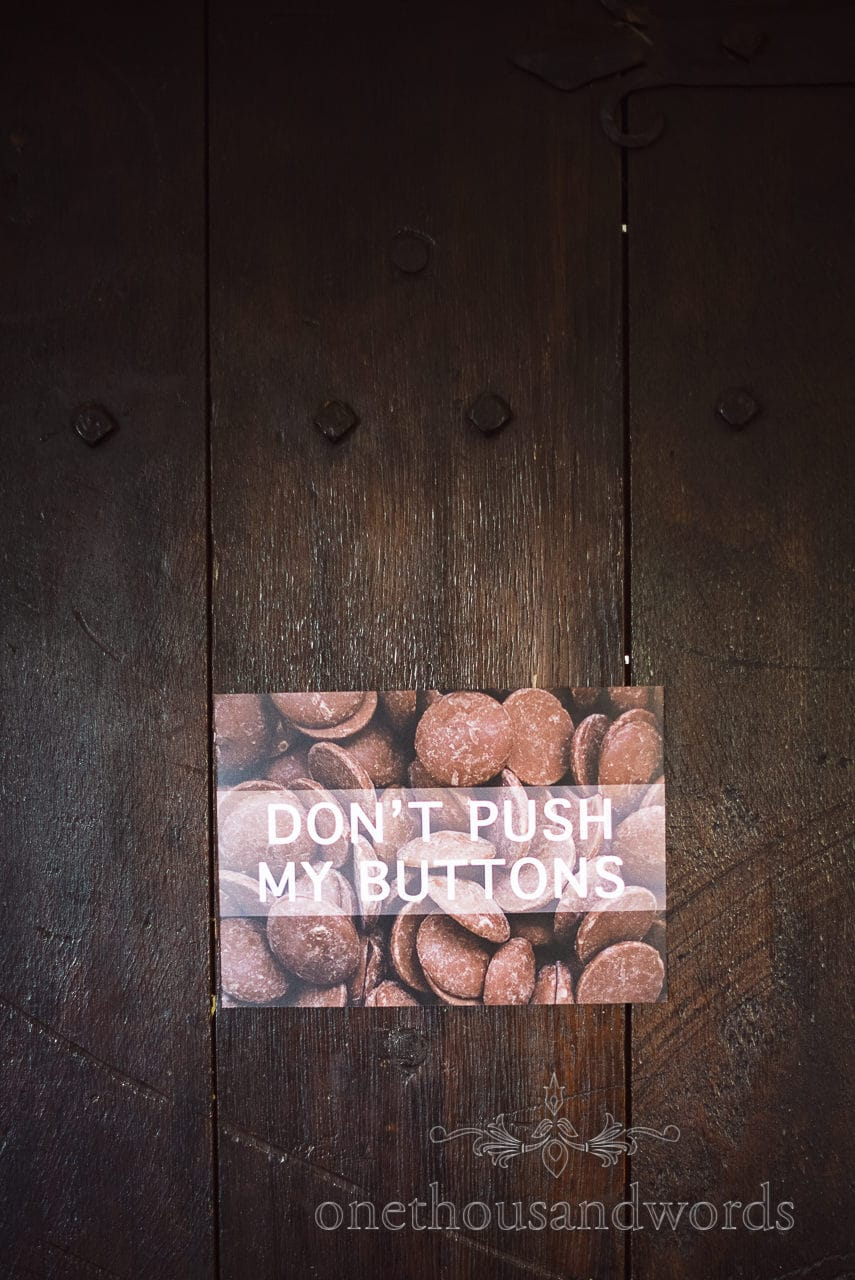 Chocolate buttons door signage from Chocolate Themed Wedding Photographs