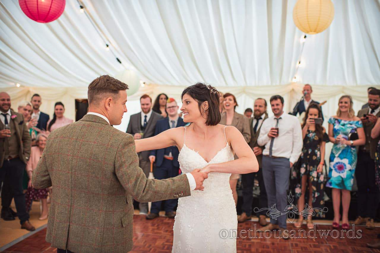 Choreographed wedding first dance with bride and groom in wedding marquee