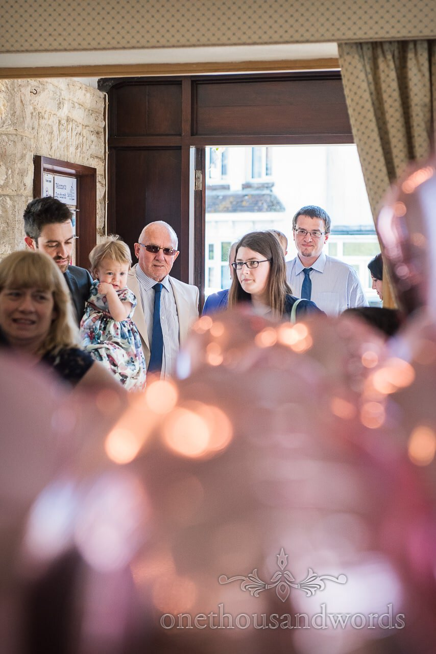 Church fills up as guests arrive for ceremony from Swanage wedding photos