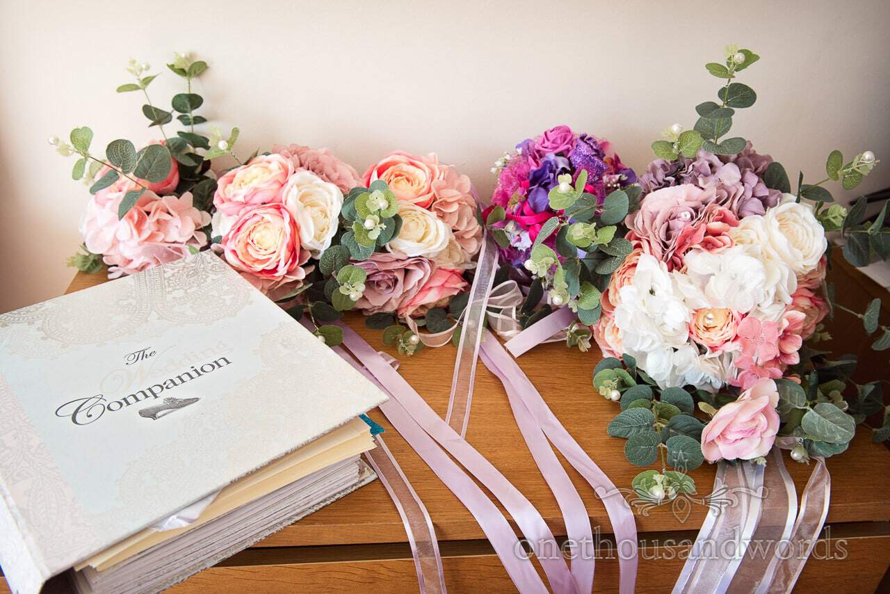 Collection of wedding bouquets and planning book from Swanage Wedding Photos